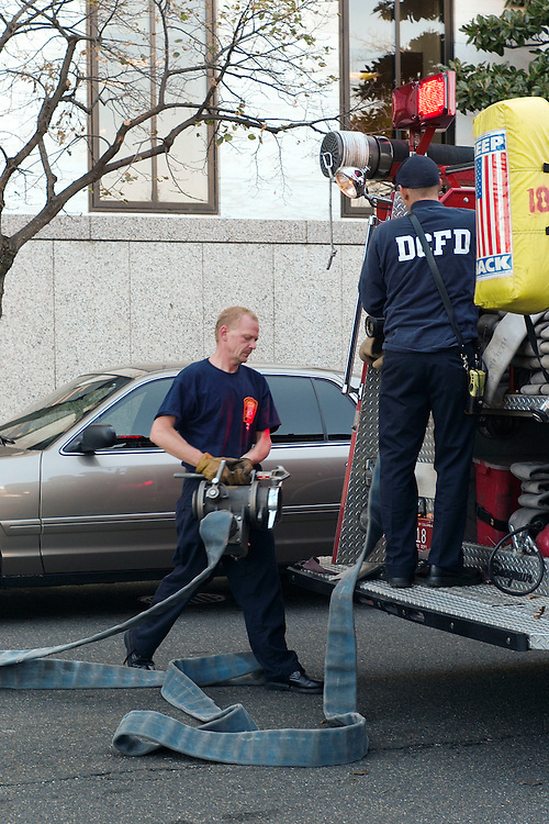 WASHINGTON, DC - Oct. 31: Washington, D.C., firefighters pack up equipment outside the Hart Senate Office Building after U.S. Capitol Police evacuated it and the Dirksen building, because of a fire in the basement of the Hart Building. Dirksen is connected to Hart. In the Capitol Building, business went on as usual, with no interruption to the Senate, which remained in session. (Photo by Scott J. Ferrell/Congressional Quarterly).