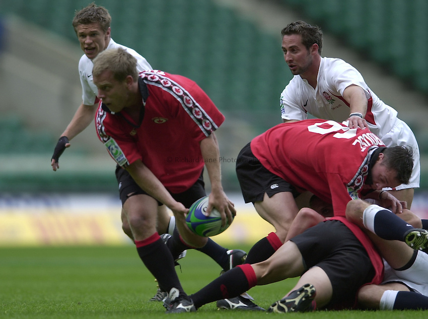 Photo Peter Spurrier.24/05/2002 (Friday).Sport -Rugby Union - London Sevens.England vs Canada.England's Nick Duncombe (L) and Ben Gollings, watch Shane Thompson move the ball away from the ruck