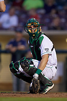 Dayton Dragons catcher Tyler Stephenson (9) looks into the dugout during a game against the Cedar Rapids Kernels on May 10, 2017 at Fifth Third Field in Dayton, Ohio.  Cedar Rapids defeated Dayton 6-5 in ten innings.  (Mike Janes/Four Seam Images)