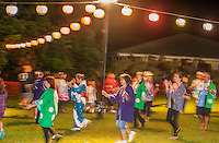 Adults dance outdoors at the Hakalau Jodo Mission Bon Dance, Big Island of Hawai'i 2014, where local families come each year to celebrate their ancestors.