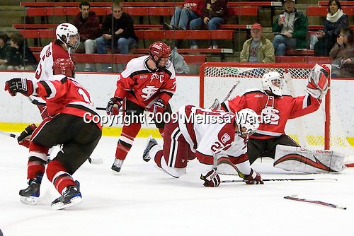 Jeff Caister (St. Lawrence - 14), Doug Rogers (Harvard - 15), Derek Keller (St. Lawrence - 7), Marshall Everson (Harvard - 21), Alex Petizian (St. Lawrence - 30) - The St. Lawrence University Saints defeated the Harvard University Crimson 3-2 on Friday, November 20, 2009, at the Bright Hockey Center in Cambridge, Massachusetts.