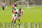 Mark Griffin for St Michaels/Foilmore dispossesses Dromid's Declan O'Sullivan on his run towards goal.