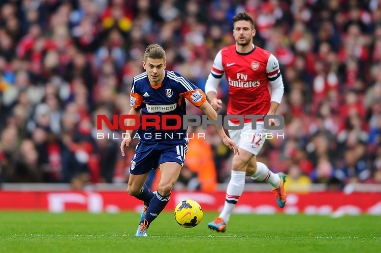 Fulham Midfielder Alex Kacaniklic (SWE)   breaks from Arsenal Forward Olivier Giroud (FRA) during the match -  - 18/01/14 - SPORT - FOOTBALL - Emirates Stadium - Arsenal v Fulham - Barclays Premier League.<br /> Foto nph / Meredith<br /> <br /> ***** OUT OF UK *****