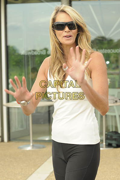ELLE MacPHERSON .Launch of Skyride - Sky's campaign to get people back on their bikes through a summer of free cycling events, Regents Park, London, England. .June 17th, 2009 .half length white black spandex shorts top sunglasses shades hands palms .CAP/CAN.©Can Nguyen/Capital Pictures.
