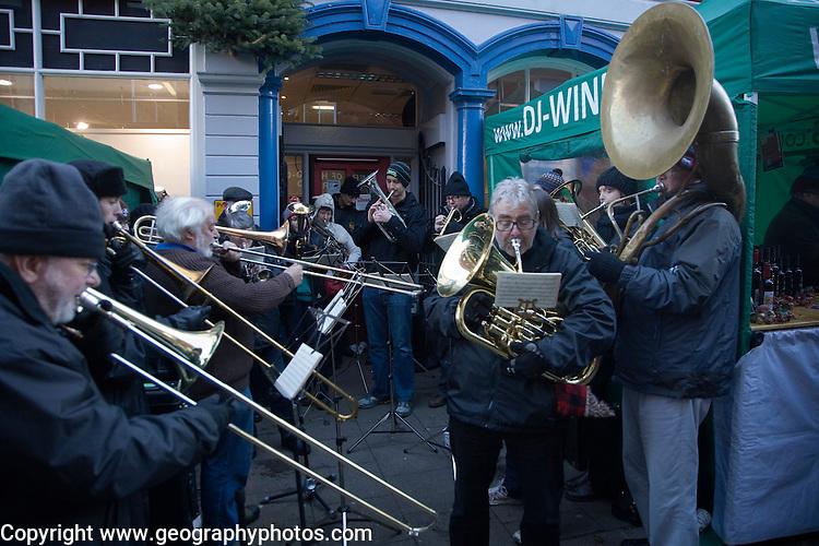 Brass band musicians perform at Christmas street fair, Woodbridge, Suffolk, England
