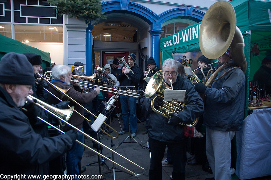 Brass band musicians perform at Christmas street fair, Woodbridge, Suffolk, England