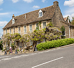 Historic stone buildings in village of  Norton St Philip, Somerset, England, UK