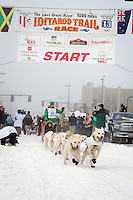 Kelly Maixner and team leave the ceremonial start line at 4th Avenue and D street in downtown Anchorage during the 2013 Iditarod race. Photo by Jim R. Kohl/IditarodPhotos.com