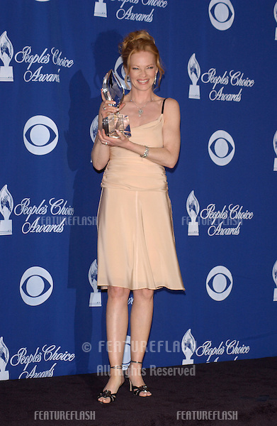 MARG HELGENBERGER at the 30th Annual People's Choice Awards in Pasadena, CA..January 11, 2004