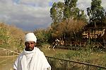 Jordan Valley, Qasr al Yahud, an Ethiopian Orthodox pilgrim at the Jordan River