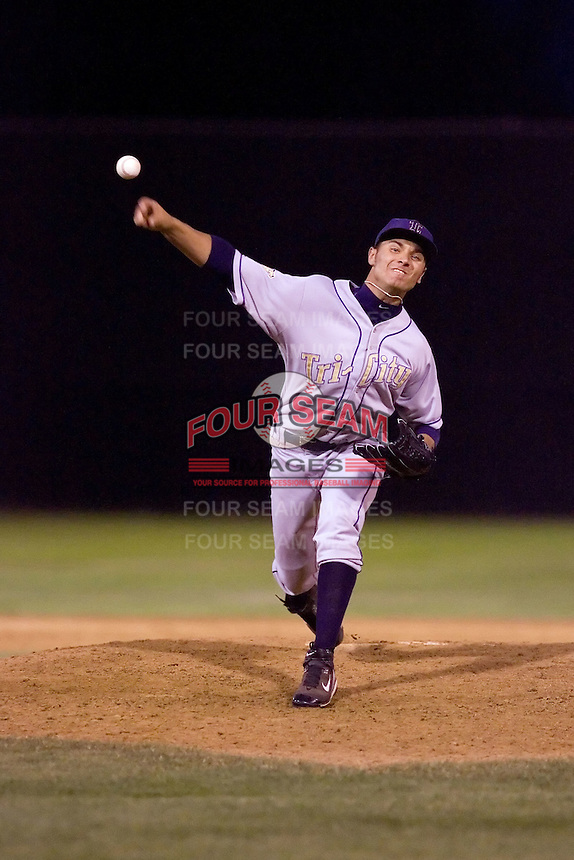 July 7, 2009: Tri-City Dust Devils' Charles Ruiz pitches against the Salem-Keizer Volcanoes during a Northwest League game at Volcanoes Stadium in Salem, Oregon.