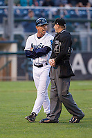 Everett Aquasox manager Rob Mummau (8) has a few words with umpire Derek Thomas after getting ejected during a game against the Spokane Indians at Everett Memorial Stadium in Everett, Washington on July 24, 2015.  Everett defeated Spokane 8-6. (Ronnie Allen/Four Seam Images)