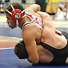 Shane Garcia of East Islip, top, battles Donny Wetherbee of Sachem North at 195 pounds during the Suffolk County Division 1 wrestling quarterfinals at Hofstra University on Friday, Feb. 12, 2016. Garcia rallied from a 4-0 deficit to record a pin at 5:41.