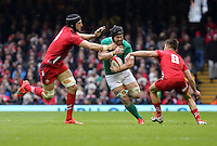 Pictured: Sean O'Brien of Ireland (C) is grabbed by Luke Charteris (L) and Rhys Webb (R) of Wales Saturday 14 March 2015<br />