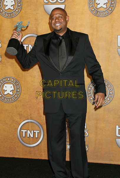 "FOREST WHITAKER.winner of the ""Male Actor In A Leading Role"" award for ""The Last King of Scotland"".13th Annual Screen Actors Guild (SAG) Awards held at the Shrine Auditorium - pressroom,  Los Angeles, California, USA, 28 January 2007..press room full length award trophy black suit.CAP/ADM/RE.©Russ Elliot/AdMedia/Capital Pictures."