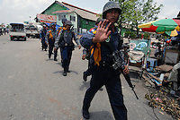 Police patrol the Yangon dockside, where aid supplies are being offloaded and other shipments are about to leave for the areas most seriously affected by Cyclone Nargis, which hit Burma in May 2008.