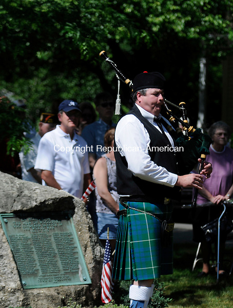 WOODBURY, CT-30 MAY 2010-053010IP04- FOR COUNTRY LIFE   John Carr of Milford plays the bagpipes during a Memorial Day ceremony at Cannon Green in Woodbury on Sunday.                                                                                                                                                                                                                                                                                                                                                                                                                                                                                                                                                                                                                                                                                                                                                                                                                                                                                                                                                                                                                                                                                                                                                                    <br /> Irena Pastorello Republican-American