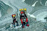 Climbers ascending Broad Peak next to K2.  Below is the Goodwin Austen Glacier