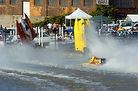 2004 Bay City River Roar, Bay City, Michigan, 26-27 June, 2004..Frame 3:.Chris Fairchild (L, #62) and Terry Rinker (R,#10) come together during the inverted start for Saturday's 2 heat race. Both boats suffer a blowover, Fairchild's boat landing upside down in the river only to be run over by Todd Bowden. During Rinkers crash, his boat snagged a pier with the lower unit, ripping it away. The boat continued skyward, hitting the staircase from the lower to the upper pier and then striking a piling with the right rear of the hull, with that large chunk falling to the pier below (to be seen in a later picture. Rinker continued his backflip, finally landing just a few feet from a docked pleasure boat filled with spectators. No one was injured in the accident and both drivers made the restart in their backup boats...©F. Peirce Williams 2004..F. Peirce Williams .photography.P.O. Box 455 Eaton, Ohio 45320 USA.p: 317.358.7326 e: fpwp@mac.com