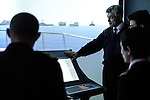 Baku - Azerbaijan - 08 December 2014 -- Azerbaijan State Marine Academy. -- Instructor and teacher Sadigov Asaf during a lesson on navigation with students in the simulator room. -- PHOTO: Sitara Ibrahimova / EUP-IMAGES