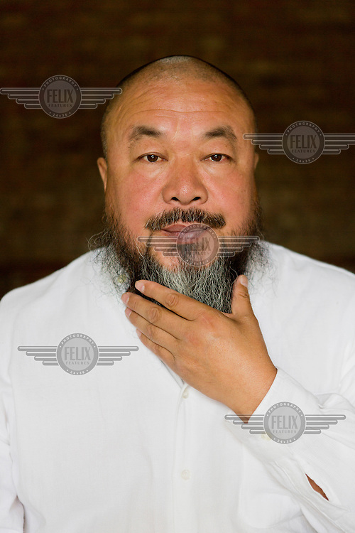 Artist Ai Weiwei poses for a portrait in his studio in Beijing.