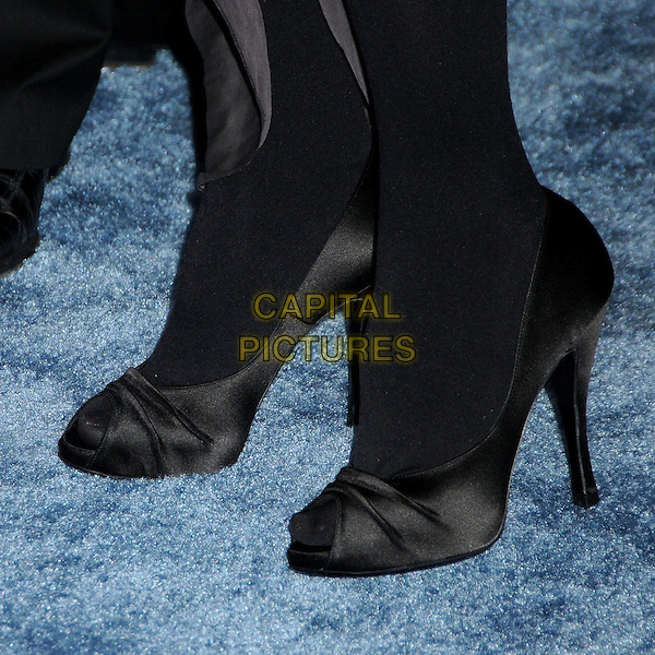 MAGGIE GYLLENHAAL's shoes.25th Annual Film Independent Spirit Awards - Arrivals held at the Nokia Event Deck at L.A. Live, Los Angeles, California, USA..March 5th, 2010.feet heels black tights silk satin .CAP/ADM/BP.©Byron Purvis/AdMedia/Capital Pictures.