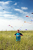 USA, Washington State, Long Beach Peninsula, portrait of a boy with his kite at the International Kite Festival