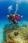 20 June 2016: SCUBA Divers Sally Herschorn and Josh Wolfstein explore the Wreck of the Doc Poulson off the shores of 7-Mile Beach on the West side of Grand Cayman Island. Located in the British West Indies in the Caribbean, the Cayman Islands are renowned for excellent scuba diving, snorkeling, beaches and international banking.  Mandatory Credit: Ed Wolfstein Photo *** RAW (NEF) Image File Available ***