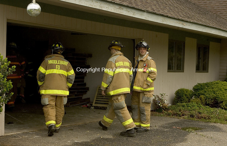 MIDDLEBURY CT--19 MAY 2007--051907JS28- Members of the Middlebury Volunteer Fire Department prepare to enter a home on Chesham Drive in Middlebury for a walk-through prior to  a live burn traning excercise on Saturday.<br /> Jim Shannon / Republican-American