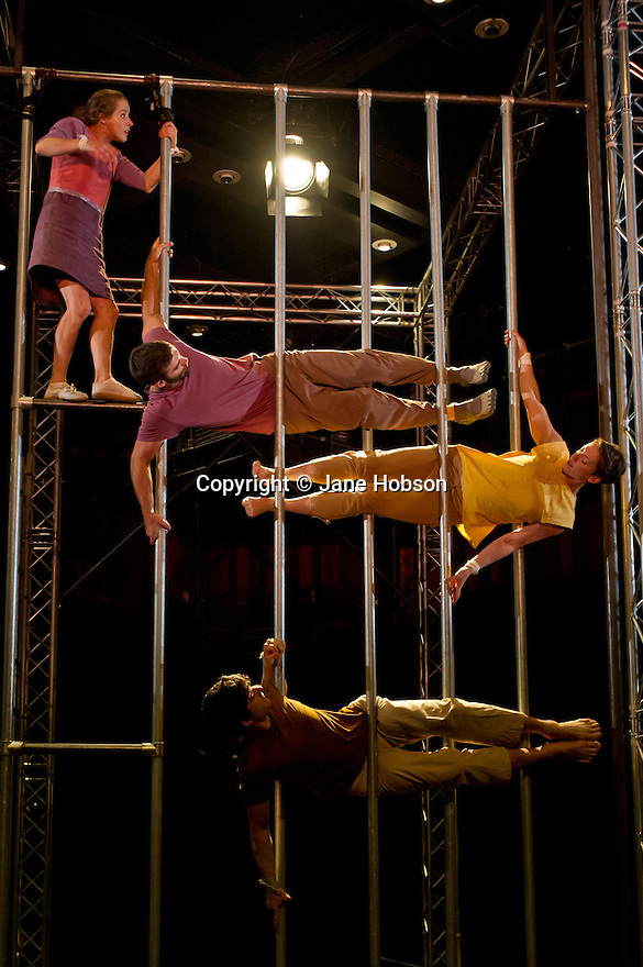 London, UK. 20.09.12. Ockham's Razor and Turtle Key Arts present the world premiere of NOT UNTIL WE ARE LOST at artsdepot. Award-winning and critically acclaimed aerial theatre company Ockham's Razor mix circus, physical theatre, story-telling and distorted perspectives with a score performed by a choir of 20 from the local community. The cast is: Alex Harvey, Charlotte Mooney, Haike Irina Amelia Stollbrock and Luke Horley. Photo credit: Jane Hobson.