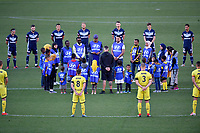 15th March 2020, Wellington, New Zealand;  The Phoenix and Victory players stand for a moment silence with members of the Christchurch community effected by the shootings one year ago during the A-League - Wellington Phoenix versus Melbourne Victory football match at Sky Stadium in Wellington on Sunday the 15th March 2020.