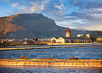 Pictures & images of the salt pans of the Nubia Salt works Museum and Nubia wind mill with Erice on the hills behind,  World Wildlife reserve of Saline di Trapani and Paceco site, Trapani Sicily.