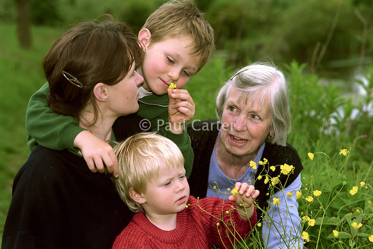 Family enjoying wild flowers along the banks of the River Itchen.