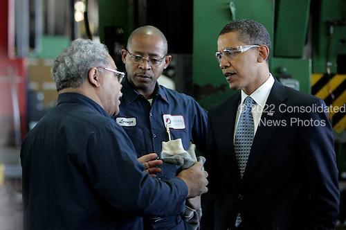 Bedford Heights, OH - January 16, 2009 -- United States President Elect Barack Obama (R) talks with workers during a tour of Cardinal Fastener & Specialty Company, Inc., in Bedford Heights, Ohio, USA, 16 January 2009.  Obama met with workers at the plant , which manufactures parts used to construct wind turbines, and spoke about an American Recovery and Reinvestment Plan, which would aim to create nearly half a million American jobs by investing in clean energy.  .Credit: David Maxwell - Pool via CNP