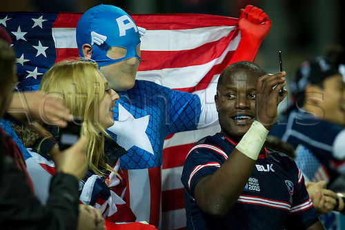 11.10.2015. Kingsholm Stadium, Gloucester, England. Rugby World Cup. USA versus Japan. Takudzwa Ngwenya of USA takes 'selfies' with USA supporters.