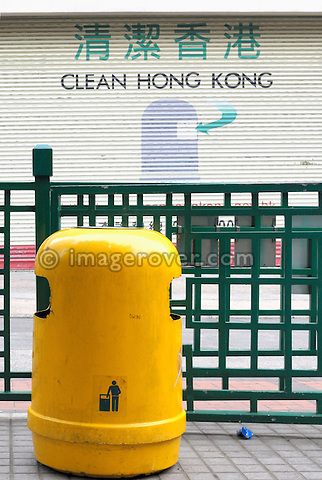 "Hong Kong, China, Asia. Hong Kong Kowloon. Waste bin and painted request ""Clean Hong Kong""."