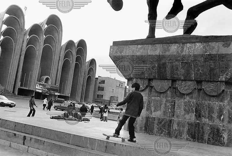 """Children skateboarding and socialising outside the """"Ears of Andropov"""" building, a monstrous architectural construction built for the local politburo to watch the annual May 1st parade. The structure was erected in the Caucasus region under Yoeri Andropov, a Soviet politician and the Secretary-General of the CPSU. The city council now wants to demolish this curiosity."""