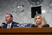 United States Representative Carolyn Maloney (Democrat of New York) listens to United States Senator Mike Lee (Republican of Utah) speak to ChairBoard of Governors of the Federal Reserve System Jerome Powell during the U.S. Congress Joint Economic Committee hearing on Capitol Hill in Washington D.C., U.S., on Wednesday, November 13, 2019.<br /> <br /> Credit: Stefani Reynolds / CNP