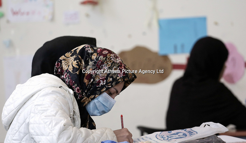 Pictured: Students taking notes Monday 06 February 2017<br /> Re: A school teaching the English language has been operating at the migrant camp located in the former airport in the outskirts of Athens, Greece.