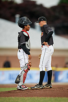 Batavia Muckdogs starting pitcher Dakota Bennett (44) talks with catcher Pablo Garcia (4) during a mound visit during a game against the Williamsport Crosscutters on June 22, 2018 at Dwyer Stadium in Batavia, New York.  Williamsport defeated Batavia 9-7.  (Mike Janes/Four Seam Images)