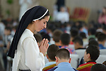 Sister Muntahah Haday prays with children preparing for first communion in a church in a displaced persons camp in Ankawa, near Erbil, Iraq. Haday is a member of the Dominican Sisters of St. Catherine of Siena, who were displaced by ISIS in 2014.