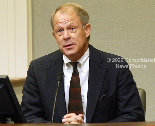 """Don Mercer, director of risk management and security for Prince William County, Virginia Schools, testifies in the trial of sniper suspect John Allen Muhammad in Virginia Beach Circuit Court in Virginia Beach, Virginia on November 9, 2003.   Mercer said """"The parents were scared, the students were scared, the staff were scared"""" during the sniper shootings. <br /> Credit: Tracy Woodward - Pool via CNP"""
