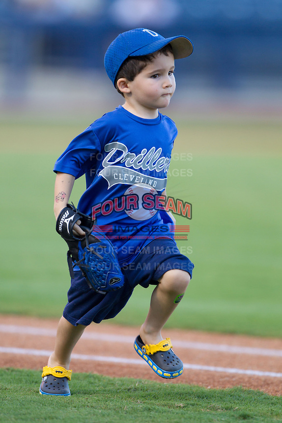 A young against the Tulsa Drillers fan runs between bases prior to the Texas League game against the Frisco RoughRiders at ONEOK field on August 15, 2014 in Tulsa, Oklahoma  The RoughRiders defeated the Drillers 8-2.  (William Purnell/Four Seam Images)