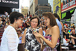 As The World Turns' Colleen Zenk poses with her daughter Kelsey and chats with Christine (Kevin's mom). Colleen is a newly ordained Universal Life Church minister who officiated the wedding on August 18, 2012 in Times Square, New York City, New York. (Photos by Sue Coflin/Max Photos)