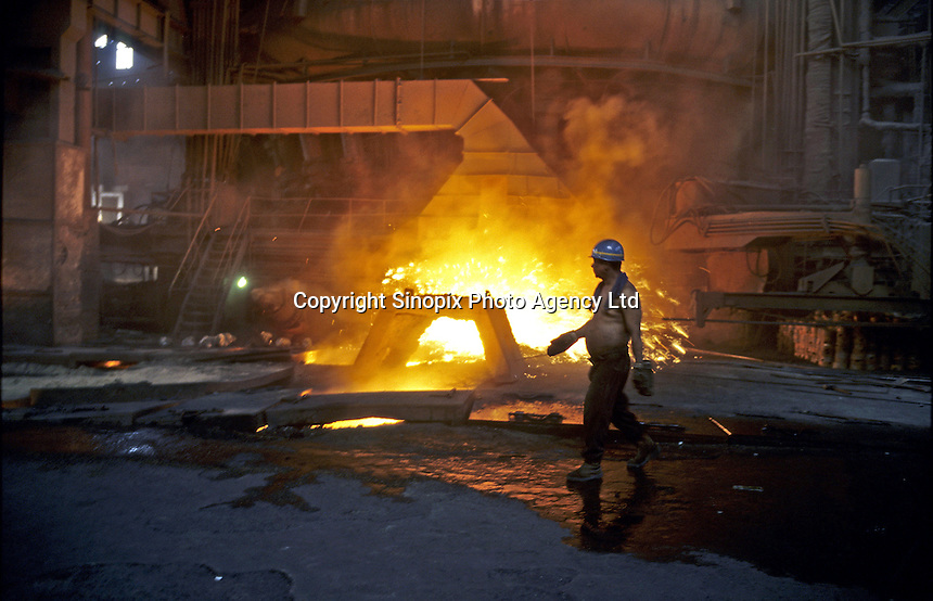 A steel worker works in a blast furnace in Benxi Iron and Steel Group in Liaoning. China's second-largest steelmaker Anshan Iron & Steel Group has merged with smaller rival Benxi Steel Group to create a company with capacity that will match the mainland's biggest steelmaker, Shanghai Baosteel Group..01 Sep 2005