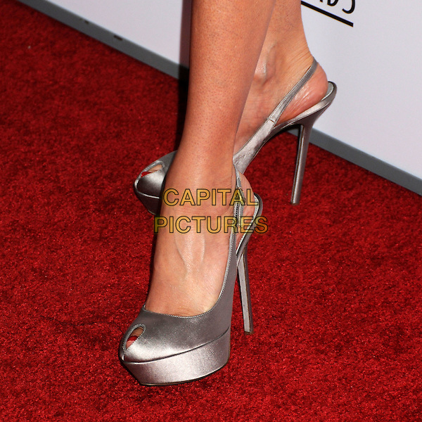 TERI HATCHER's shoes .24th Annual Genesis Awards - Arrivals held at the Beverly Hilton Hotel, Beverly Hills, California, USA, 20th March 2010..detail feet platform grey gray peep toe slingbacks shoes silk satin .CAP/ADM/BP.©Byron Purvis/AdMedia/Capital Pictures.