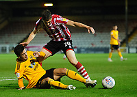 Lincoln City's Adam Crookes vies for possession with Wolverhampton Wanderers U21's Pedro Goncalves<br /> <br /> Photographer Chris Vaughan/CameraSport<br /> <br /> The EFL Checkatrade Trophy Northern Group H - Lincoln City v Wolverhampton Wanderers U21 - Tuesday 6th November 2018 - Sincil Bank - Lincoln<br />  <br /> World Copyright © 2018 CameraSport. All rights reserved. 43 Linden Ave. Countesthorpe. Leicester. England. LE8 5PG - Tel: +44 (0) 116 277 4147 - admin@camerasport.com - www.camerasport.com
