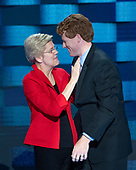 United States Senator Elizabeth Warren (Democrat of Massachusetts), left, and US Representative Joe Kennedy III (Democrat of Massachusetts), right, on the podium of the 2016 Democratic National Convention held at the Wells Fargo Center in Philadelphia, Pennsylvania on Saturday, July 23, 2016.  Kennedy had just completed his remarks introducing Warren who is one of the marquee speakers.<br /> Credit: Ron Sachs / CNP