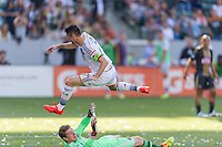 CARSON, CA - May 25, 2014: Los Angeles Galaxy forward Robbie Keane (7) rushes Philadelphia Union goalkeeper Zac MacMath (18) during the LA Galaxy vs Philadelphia Union match at the StubHub Center in Carson, California. Final score, LA Galaxy 4, Philadelphia Union  1.