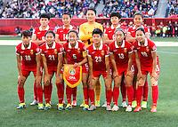 WINNIPEG, MANITOBA, CANADA - June 15, 2015: The Woman's World Cup China vs New Zealand match at the Winnipeg Stadium.  Final score China 2, New Zealand 2.